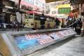 A fallen sign on Nanking Street in Yau Ma Tei. Photo: Handout