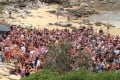 Police help shut down a drunken beach party of 3,000 backpackers Christmas Day at Little Bay Beach in Sydney. Photo: Randwick City Council