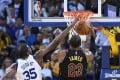 Kevin Durant of the Golden State Warriors blocks LeBron James' shot late in the fourth quarter. Photo: AFP