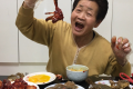"""Kim Young-won, a 77-year-old host of YouTube channel """"Youngwonssi TV _ Funny Grandmother,"""" tries new foods during the mukbang (eating show) broadcasting, at her home in Yongin, Gyeonggi Province. Photo: Youngwonssi TV"""