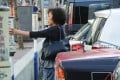 A woman pays for her parking fare in a parking meter at Victoria Park in Causeway Bay. Photo: K. Y. Cheng