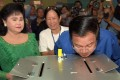 Cambodian Prime Minister Hun Sen looks at a ballot box after he cast his vote a polling station for local polls in June. File photo: AFP