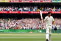 England's Alastair Cook acknowledges the crowd as he walks off the ground at the end of the third day of the fourth Ashes test. Photo: Reuters