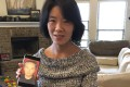 Zhang Haitao's wife Li Aijie shows a picture of her husband. Li is now seeking political asylum in the United States. Photo: AP