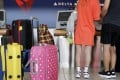 Some travellers looking to take a cheap Delta Air Lines flight will soon need to pay for even one piece of checked baggage when flying to Europe or North Africa. Just one early sign of a turbulent 2018. Photo: AP