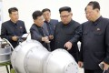 North Korean leader Kim Jong-Un (second right) in an undated photograph released by North Korea's official Korean Central News Agency on September 3, the day his country's staged its latest and biggest nuclear weapons test. Photo: AFP/KCNA via KNS