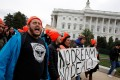 Protesters call for an immigration bill addressing the so-called Dreamers, young adults who were brought to the United States as children, as they rally on Capitol Hill in Washington on December 20. The Dreamers' future is now tied to Donald Trump's Mexico border wall, according to the president. Photo: REUTERS