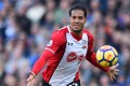Virgil van Dijk shepherds the ball against Brighton and Hove Albion. The defender has joined Liverpool. Photo: AFP
