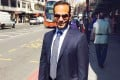 George Papadopoulos poses on a street in London. The former Trump campaign aide has pleaded guilty to lying to the FBI about the nature of his communications with the Russians. Photo: AFP