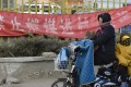 A banner in a Beijing suburb this month reads 'Don't bring coal to the village'. Photo: Kyodo