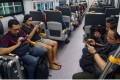 Passengers on the newly launched airport train in Tangerang, on the outskirts of Jakarta. Photo: AFP