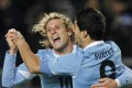 Uruguay's Diego Forlan celebrates with Luis Suarez during their Copa America semi-final win in 2011. Photo: Reuters