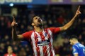 Diego Costa celebrates after scoring on his return for Atletico Madrid. Photo: EPA
