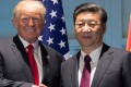 FILE PHOTO - U.S. President Donald Trump and Chinese President Xi Jinping (R) shake hands prior to a meeting on the sidelines of the G20 Summit in Hamburg, Germany, July 8, 2017. REUTERS/Saul Loeb/ Pool/File Photo TPX IMAGES OF THE DAY