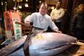 Kiyoshi Kimura, president of sushi restaurant chain Sushi-Zanmai, displays a 190kg bluefin tuna at his main restaurant near Tokyo's Tsukiji fish market. Photo: AFP