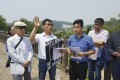 Hwang In-cheol (third left) on the Friendship Bridge in Panmunjeon with members of Seoul-based charity Teach North Korean Refugees and supporters in 2016 as he campaigns for his father's return. Photo: Hwang In-cheol