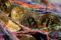 A bitcoin transaction requires six confirmations before it is processed. Photo: Bloomberg