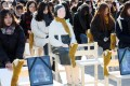 """A """"comfort woman"""" statue and portraits of late victims of Japan's wartime sexual slavery system occupy some of the 300 chairs placed at Seoul's Gwanghwamun Square, as demonstrators take part in a performance themed """"A Promise Inscribed on an Empty Chair"""", on December 27. Photo: EPA-EFE/Yonhap"""