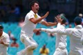 Australia's Pat Cummins celebrates with teammates after dismissing England's Jonny Bairstow during the fifth day of the fifth Ashes test match. Photo: Reuters