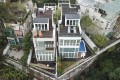 Houses belonging to Secretary for Justice Teresa Cheng Yeuk-wah (left) and her husband Otto Poon Lok-to in Tuen Mun. Photo: Winson Wong