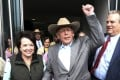 Cliven Bundy walks out of federal court with his wife Carol on Monday in Las Vegas, after a judge dismissed criminal charges against him and his sons accused of leading an armed uprising against federal authorities in 2014. Photo: AP
