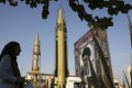 A Ghadr-H missile, centre, a solid-fuel surface-to-surface Sejjil missile and a portrait of the Supreme Leader Ayatollah Ali Khamenei are displayed at Baharestan Square in Tehran, Iran, in September 2017. Photo: AP