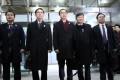 South Korean Unification Minister and chief delegate Cho Myoung-gyon (centre) and delegates pose at the South-North Dialogue Secretariat building in Seoul before leaving for the border village of Panmunjom. Photo: EPA