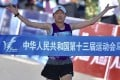 Wang Jiali crosses the finish line to win the women's marathon at the 2017 National Games. Photos: Xinhua