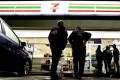 US Immigration and Customs Enforcement agents raid a 7-Eleven convenience store on Wednesday in Los Angeles. Agents said they targeted about 100 7-Eleven stores nationwide in a crackdown against illegal workers. Photo: AP