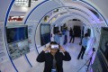 A visitor tests a virtual reality device at the International Big Data Expo in Guiyang, capital of Guizhou province in southwest China. One of the country's poorest provinces, Guizhou is being transformed into a world-class hi-tech hub. Photo: Xinhua