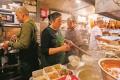 Chiu Chow Delicacies staff (from left) Li Wei Huang, Peng Bing, Lam Shek-hing and Ma Zhen Ting work in the restaurant's kitchen in North Point. Photo: Xiaomei Chen