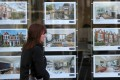 A property agent's window in London. Asking prices for London homes fell by most since 2009 in January. Photo: EPA