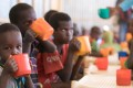 Young children drink a high protein mix provided by the World Food Programme (WFP) during a school feeding programme at Mekladida refugee camp in the Somali region of Ethiopia on December 19, 2017. Somali security forces destroyed 23 camps and people are being forced to live rough. Photo: AFP