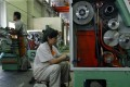 Chinese workers are seen on the production line of Shenyang No 1 Machine Tool Works in Liaoning province in this file photo from 2004. Once the crown jewel of China's centrally planned economy, today the northeast is the country's rust belt, but e-commerce giant JD.com wants to help revitalise the area. Photo: Reuters