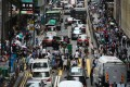 Traffic inches forward as parked vehicles clog the roads in Central. Photo: Jonathan Wong