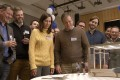 Kristen Wiig and Matt Damon (centre) consider a smaller life in the film Downsizing.