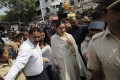 Bollywood actor Deepika Padukone, escorted by police to offer prayers at a Hindu temple ahead of the release of her upcoming film Padmaavat. Photo: AP