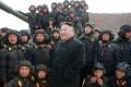 Kim Jong-un with tank crews. Photo: TNS