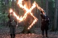 Two neo-Nazis burn a swastika in undercover footage recorded in Poland on April 20, 2017. The country – which was invaded, occupied and prutalised by Nazi Germany – has reacted in horror at the newly aired footage. Screengrab: TVN24