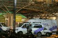 Police vans in front of the Ghent Sint-Pieters train station, after a shooting incident, in Ghent, Belgium, on Tuesday. Police have shot a man armed with a knife at the main railway station in the western Belgian city. Photo: EPA-EFE