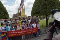 A group of Chinese tourists pose for a picture before visiting the Grand Palace in Bangkok. Photo: AFP