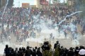 Demonstrators clash with riot police and soldiers during a protest in Tegucigalpa, Honduras. Photo: Reuters