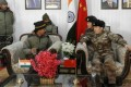 Indian and Chinese troops hold a border personnel meeting to mark India's 69th Republic Day on Friday. Photo: Twitter