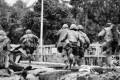 US marines sprint through the rubble of the citadel in Hue, South Vietnam, after its walls were breached by tank fire in February, 1968. Photo: Alamy