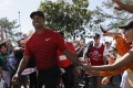 Tiger Woods greets fans during the Farmers Insurance Open where he enjoyed a solid return to action. Photo: AP