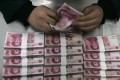 Activity in the dim sum bond market could increase if internationalisation of the yuan accelerates. Photo: Reuters