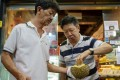 A customer sampling durians at Mao Shan Wang café in the Chinatown district of Singapore. Photo: AFP