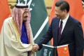 Chinese President Xi Jinping and Saudi Arabia's King Salman shake hands in Beijing on March 16, 2017, after signing 14 agreements on economic cooperation worth US$65 billion. Photo: Kyodo
