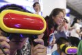 Visitors play VR video games at the 20th China Beijing International High-Tech Expo (CHITEC) opens in Beijing in June last year. Phioto: SCMP