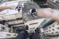 A still from a video released by the Storror parkour collective shows members leaping across rooftops in Tsim Sha Tsui, Hong Kong. Photo: courtesy of Facebook